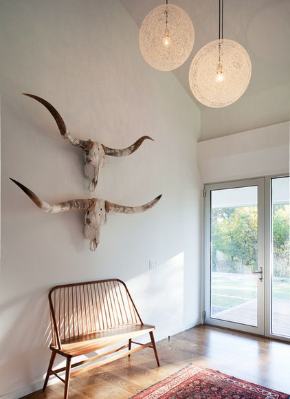 Longhorn skulls are iconic symbols of the desert Southwest. They look especially celebrated in this minimalist, modern foyer.
