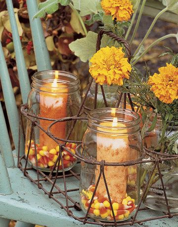 Mason-jars, candy corn and a candle (sitting in what looks to be the rack from an old canner)Decor Ideas, Fall Decor, Candles Holders, Candy Corn, Candies Corn, Candycorn, Jelly Beans, Mason Jars Candles, Fall Wedding