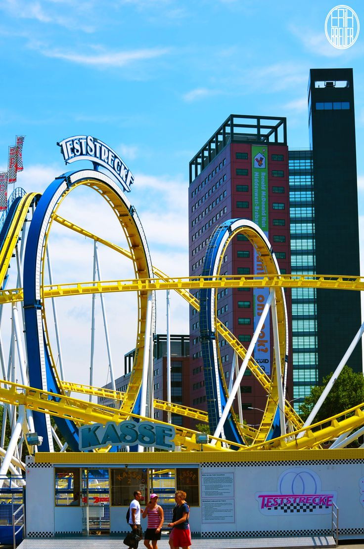The biggest rollercoaster on the fair. On the background you'll see one of the famous buildings in Tilburg: The Interpolis Building - Tilburgse Kermis 2014