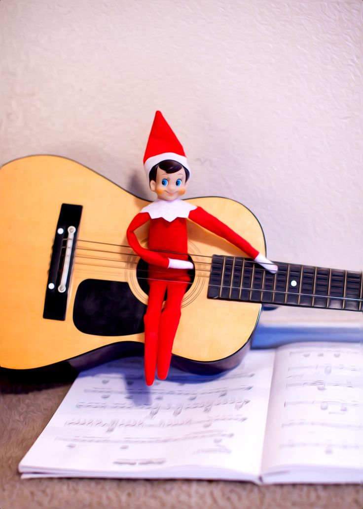 elf on the shelf : playing the guitar