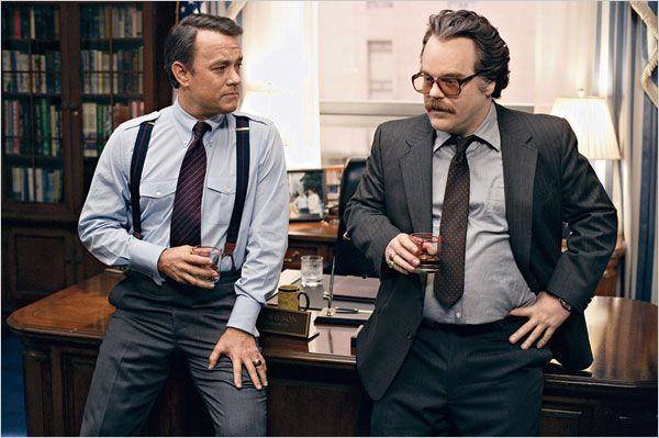 Tom Hanks and Phillip Seymour Hoffman as Charlie Wilson and Gust Avrakotos in Charlie Wilson's War.