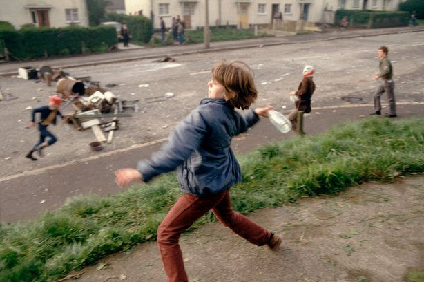 During a march through Catholic West Belfast in support of Bobby Sands on the 59th day of his hunger strike, young rioters break away to attack the police, Belfast, Northern Ireland, 1981  Peter Marlow