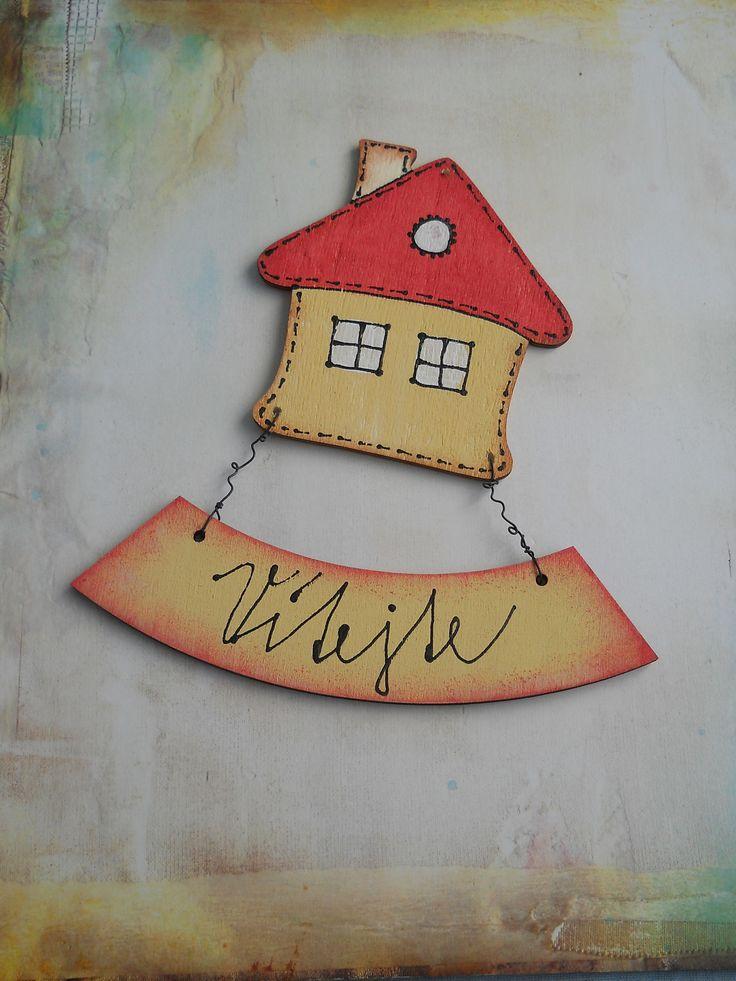 Cedulka+na+dveře+Dřevěná+cedulka+na+dveře+vyrobená+z+topolové+překližky,černého+drátu+a+domalovaná+akrylovými+barvami.+Na+cedulku+je+možné+napsat+Vaše+příjmení+nebo+text.+Např.:+Vítejte,+Vítáme+Vás,+Šťastný+domov,+Domácí+štěstí+atd....+Cedulku+je+vhodné+umístit+do+interiéru,+tzn.+panelákové+dveře+a+pokud+bydlíte+v+rodinném+domě,+určitě+najdete+pro+...