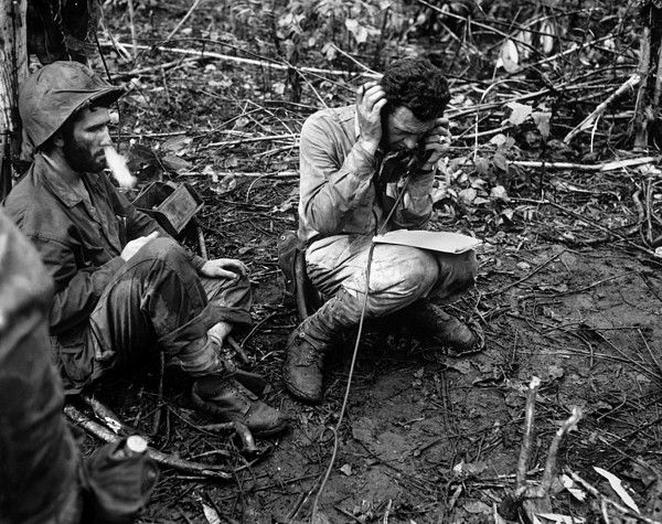 Commanding officer of a Marine battalion communicates with a 'walkie-talkie'. Lt. Colonel John Weber talks to company commanders during combat against the Japanese on Cape Gloucester, New Britain, Jan. 1944.