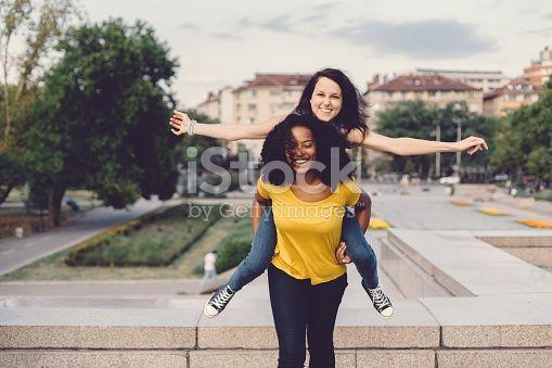 Mixed race girls having fun in the park