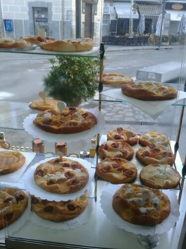 Views from inside the pastry in Soller Square, plenty of ensaimadas with some sobrasada on it. sweet delicious cake.