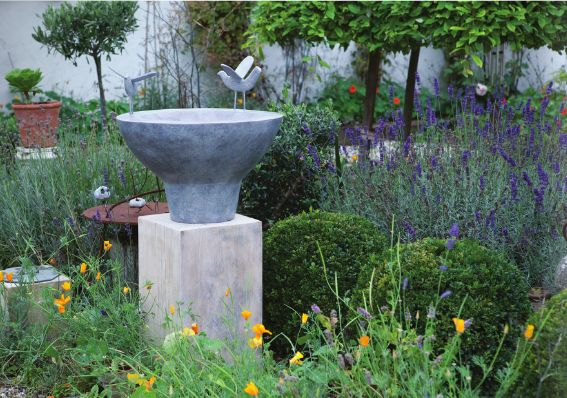 A garden with a Christopher Marvell sculpture