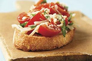 Quick Bruschetta for Two recipe - The classic flavor pairing of tomatoes, basil and mozzarella comes together with zesty dressing on a toasted slice of bread. A smart app just for the two of you to enjoy.