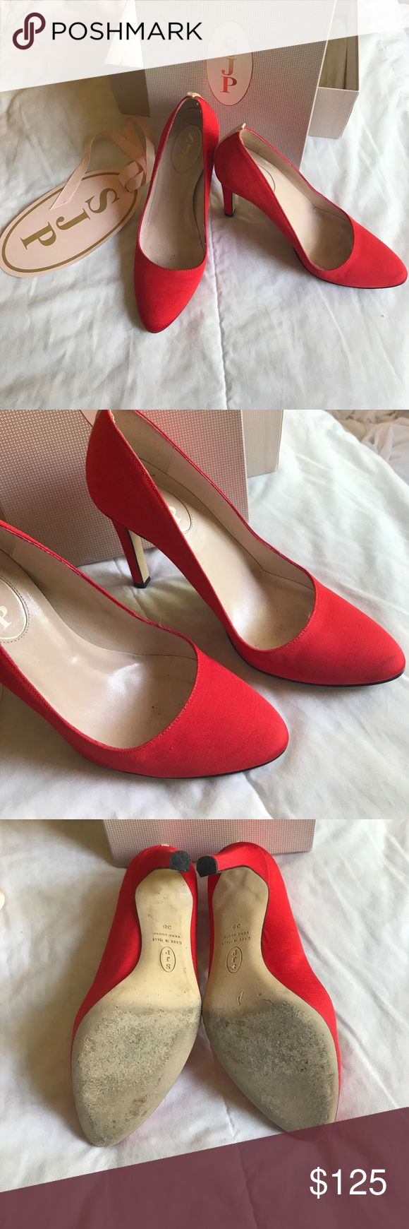 "SJP Lady pumps Size 38 (8) Lady pumps in red. Worn only a few times and has a small scuff mark on the tip of the right toe (have not tried to remove it with cleaner). Heal height is 4"". Material is grosgrain with the signature grosgrain backing. Please only interested buyers. These were purchased at full retail price of $375. Box included. SJP by Sarah Jessica Parker Shoes Heels"