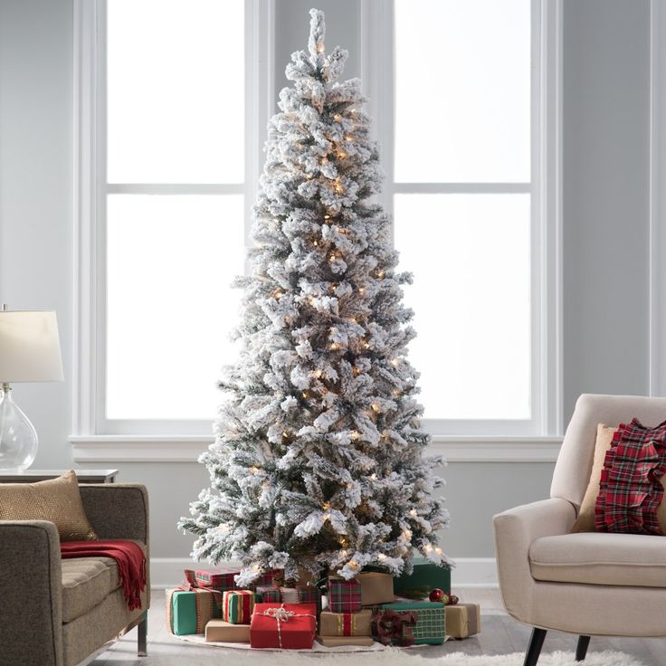 Classic Flocked Slim Pre-Lit Christmas Tree - There's nothing that says Christmas quite like fresh snow on the trees, and no matter when you put up the Classic Flocked Slim Pre-Lit Christmas Tree...