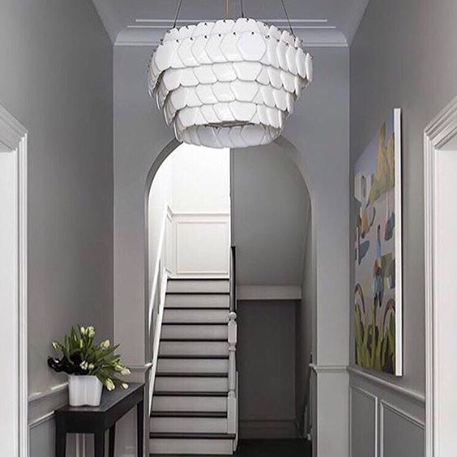 Welcome home!! ..... ..... The Cranton Pendant from @originalbtc is a magnificent statement piece which looks stunning in this calm neutral hallway . Made of discs of hexagonal bone china hand crafted in the UK which when lit produce a warm ambient light with striking forms and shadows.  #handcrafted #britishlighting #lumisonlighting #brightideas  Photo credit @dunlinhome via @originalbtc