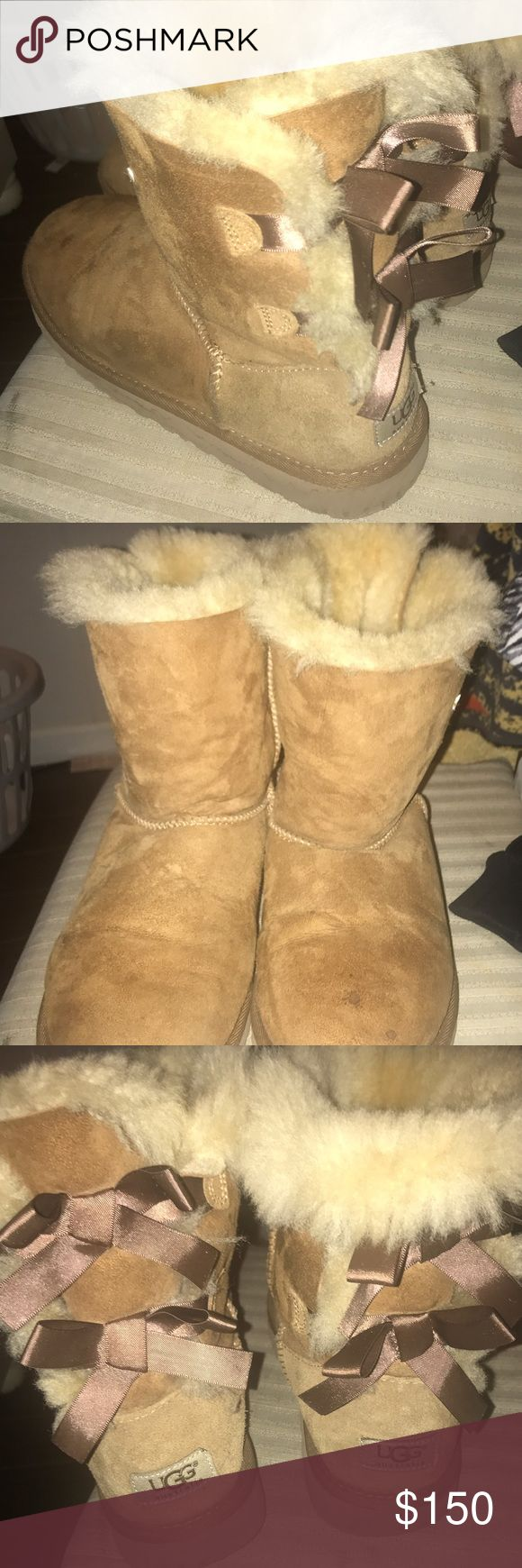 Cut Ugg Boots Supper cute original ugg boots with bows on back fairly used with very small water stains but look great! UGG Shoes Winter & Rain Boots