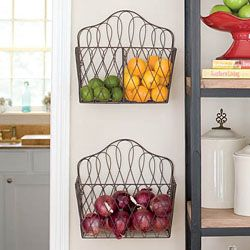 Using magazine racks to hold produce in kitchen. Willow House Wire baskets!