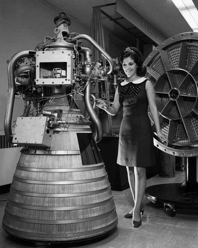 Miss NASA 1968: In the late 1960s/early '70s, NASA held a beauty pageant. This is Miss NASA 1968-69, standing by a RL-10 engine display in the Rocket Operations Building.