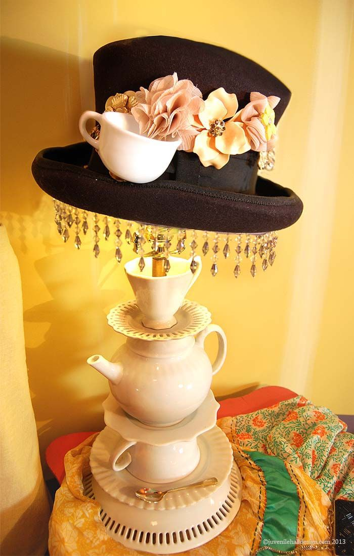 Tea cup lamp base from anthropologie :) I just inherited a small portion of Grandma's dishes. This would be a good use and way to keep them all together.