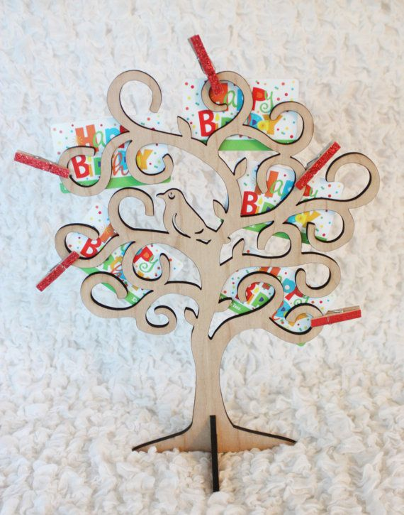 *****As seen on GiftCards.com***** Best Gift Card Trees, Bouquets and Gift Card Wreaths Ever! http://www.giftcards.com/gcgf/fun-holiday-gift-card-tree-and-gift-card-wreath-ideas  SimpleImagesStudios is proud to offer this beautiful and unique wooden gift card tree. A special way to display and present gift cards, cash money, lottery tickets, concert tickets, pictures, jewelry or anything else small and lightweight. Laser cut from cherry wood, the tree with its resident Rob...
