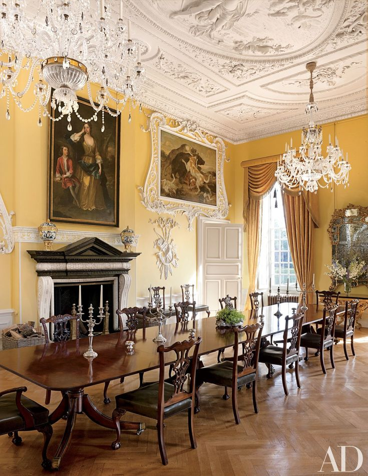 Fashion designer Leon Max restored this 1702 house in Northamptonshire, England, with Ptolemy Dean Architects and Spencer-Churchill Designs. The Yellow Dining Room's ornate stuccowork dates from the 1730s, the portrait of the first Duchess of Grafton and her son is by Sir Godfrey Kneller, and the hunting scene is attributed to Paul de Vos.