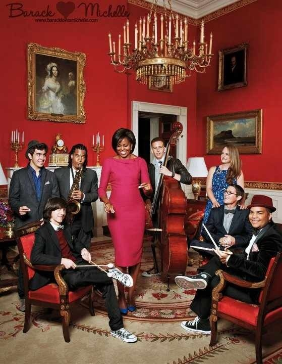 First Lady Michelle Obama donned her own L'Wren Scott sheath for the photo shoot and posed with musicians Jason Yoder, Antonio Madruga, Elijah Easton, Zach Brown, and Kush Abadey and glass artists Carmen Salazar and Caleb Siemon. Photo by Jason Schmidt.