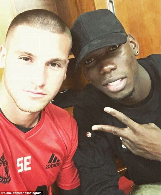 Sam Johnstone (left) poses with new Manchester United midfielder Paul Pogba (right)