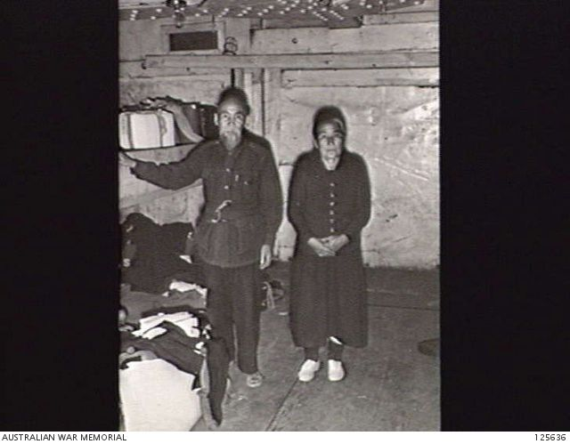 PORT MELBOURNE, VIC. 1946-02-21. AN ELDERLY JAPANESE COUPLE IN THE CRAMPED FAMILY QUARTERS BELOW DECK OF THE KOEI (KOYEI) MARU. THE SHIP, A FORMER MINELAYER STILL CREWED BY JAPANESE NAVAL ...