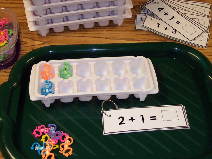 math center with ice cube trays & barrel of monkeys - hmmmm, might there be a way to cut off 2 of the cubes to make a 10-tray? Lots of other hands-on math activities at http://www.kidsworldexploration.com/id82.html