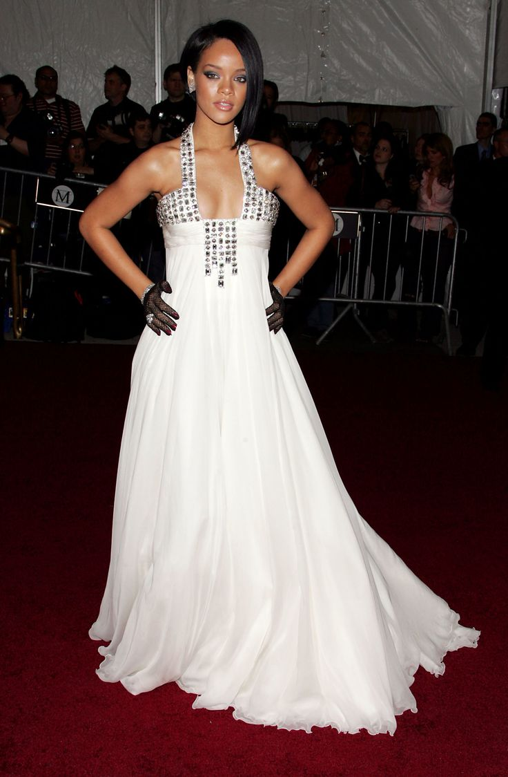 Rihanna--fearless fashion icon that she is--wore a flowing white dress with gems galore to her first Met Gala in 2007, and of course she edged up the look by accessorizing with a pair of mesh gloves.