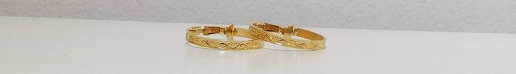 "1 1/8"" wide gold tone cip on hoop earrings. The band is 1/8"" wide with a scroll design. Signed, LH Segal California."