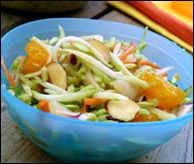Crunchy Sassy Chinese Slaw -- Quick and easy using bottled dressing.  HungryGirl says about 1 cup has 111 calories, 3.5g fat, 375mg sodium, 17.5g carbs, 4g fiber, 10g sugars, 3g protein (Diabetic Exchanges are probably 1 Starch 1/2 Fat)