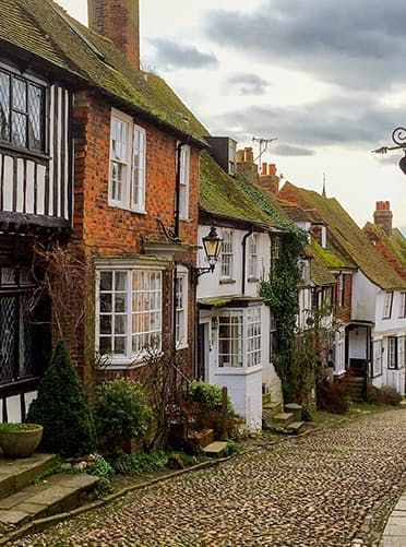 The town of Rye, England. Traveling to this well-preserved medieval town near the coast in East Sussex is like stepping back in time. Independent booksellers, cafés, seafood shops and quaint guesthouses occupy the Georgian buildings along narrow cobblestone streets.
