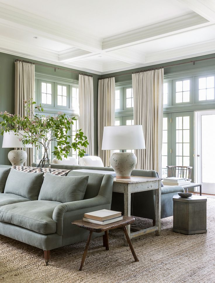 sophisticated sage green ivory and wood living room