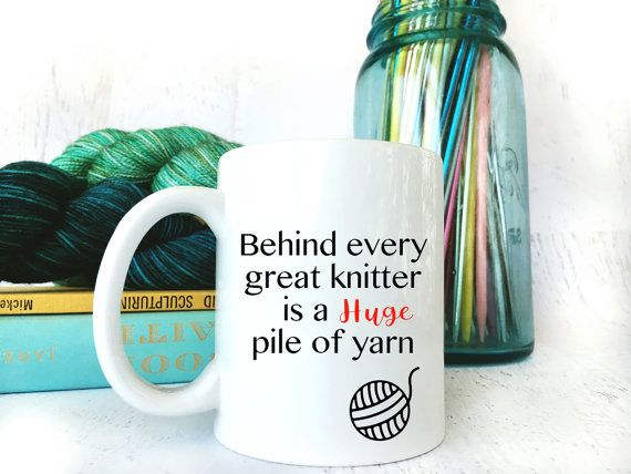 Looking for a little knitting humor? Here is the perfect coffee mug for knitters Behind every great knitter is a huge pile of yarn. Makes a wonderful gift for all fiber enthusiasts & its just perfect for the office too.  This ceramic mug is white with black vinyl lettering. The commercial vinyl is very strong and will not come off with heat from your coffee or tea but it does need to be hand washed which takes about 20 seconds. Cup holds 11 oz total. Want to change the font? Do you have a...