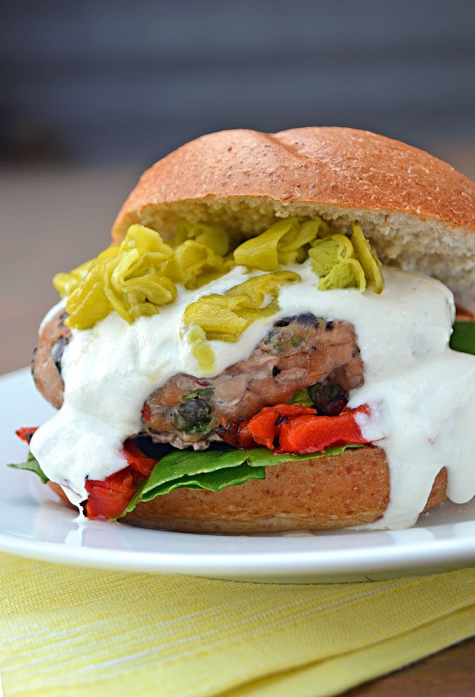 Greek Turkey Burger with Feta-Yogurt Sauce. Scallions, kalamata olives, capers, and tasty spices make this a flavorful turkey burger. Big hit with the family!