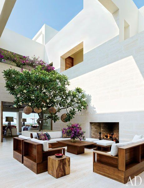A frangipani tree lends a verdant note to Cindy Crawford and Rande Gerber's Mexico villa's courtyard, which is furnished with teak tables and seating custom made by Jasper; the cushions are upholstered in a Ralph Lauren Home fabric, and the accent pillows are by John Robshaw.Pin it.See how top designers and architects are decorating their dining rooms From bright lemon to rich saffron, discover beautiful yellow rooms from the pages of AD See the special board of holiday inspiration fashion…