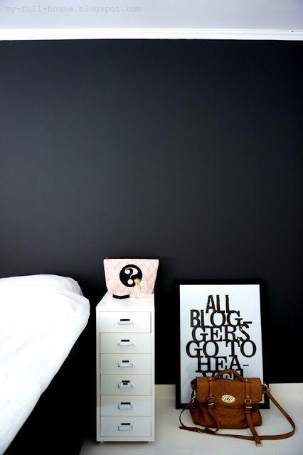 Bedroom, dark wall, white floor.