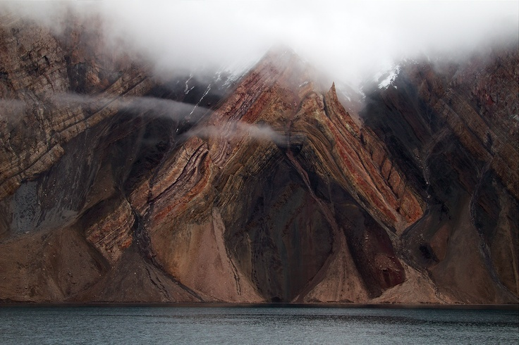 That is quite possibly one of the most awesome anticlines I've ever seen. I wonder who cut the mountain open.