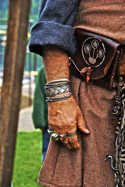 I love the colours and textures of this garb; the owner has good taste and an eye for detail. Merchant at Viking Fest by taylor.a, via Flickr
