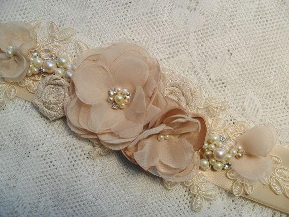 This gorgeous lace and floral sash will add that special finishing touch to your bridal or special occasion look. Handmade with chiffon, organza,