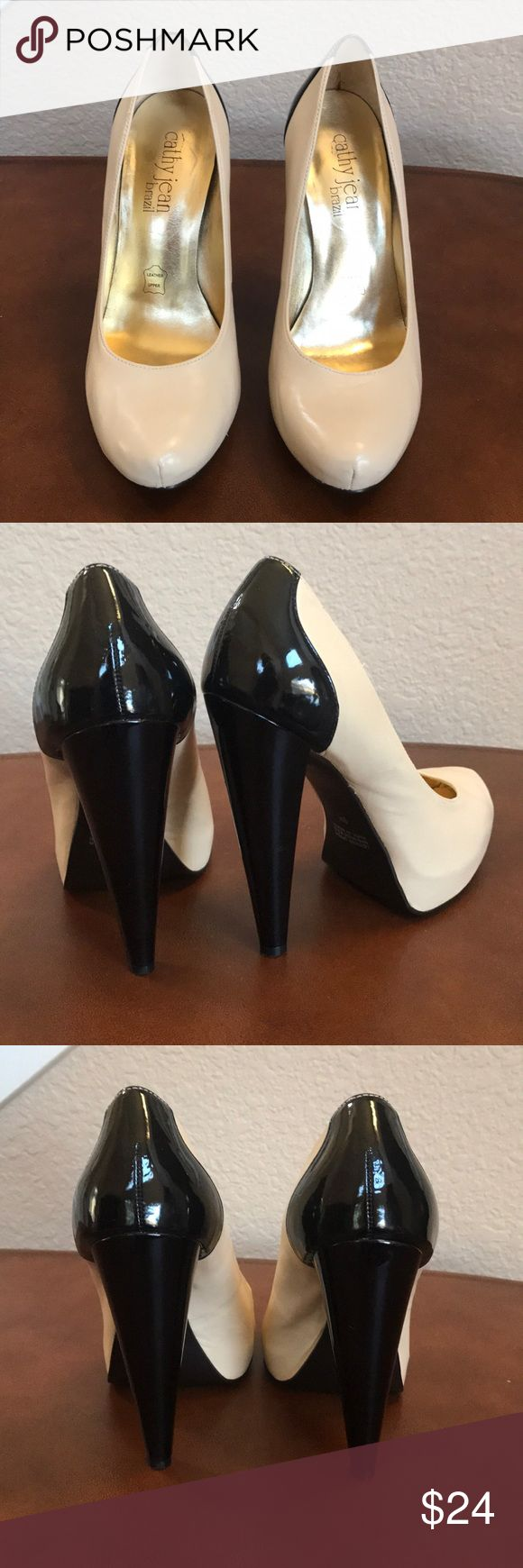 Cathy Jean Platform Pumps Gently used creme and black leather platform pumps. Signs of wear pictured, but still in good condition.   Heel height: 5 Cathy Jean Shoes Platforms