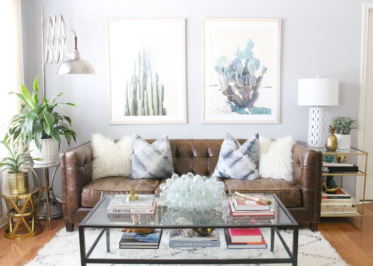 Katie's space is bright, fun and welcoming. bright and cozy eclectic living room- love the cactus art