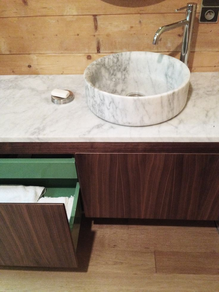 storage and washbasin unit in carrrare marble and wallnut by marmo spirito