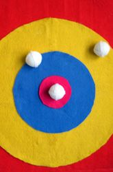 Dart board with felt and velcro. This would be perfect for my sensory area. You could add letters, colors or questions to it to make it interactive for any lesson.