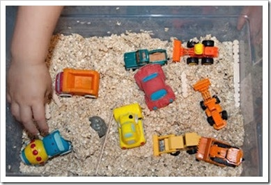 Sensory bin with oatmeal-PERFECT for children who love to explore & have imagination! Within minutes, you have a construction site full of bulldozers & front end loaders or a desert filled with roaming dinosaurs!