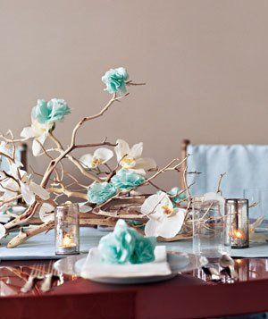 • Real Simple used a mix of faux and natural blooms to create their festive centerpiece. For a how to, visit their website. And for tips on ...