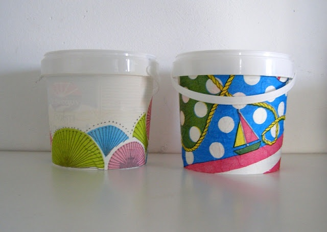 recycled yoghurt canisters as flower pots