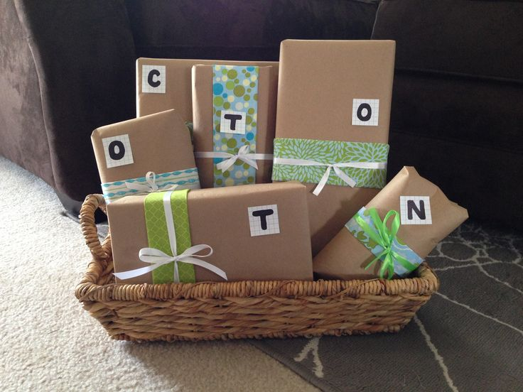 """2nd Anniversary gift for """"COTTON"""" C=corn hole bags O=dOnut hOles (that have a note that says """"Donut you know I Love you a Hole bunch"""") T=T-shirt T=harmony TV remote O=Infused Olive Oil sampler set N=bag of Pistachio nuts"""