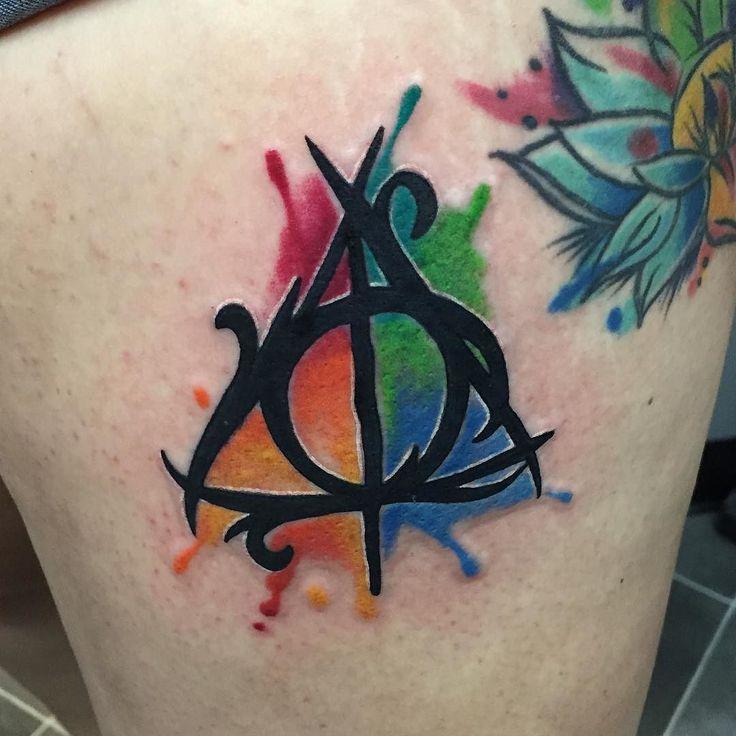 #tattoo #tattoos #harrypotter #deathlyhallows #deathlyhallowstattoo #watercolor #watercolortattoo #timelesstattoos by skylertimeless