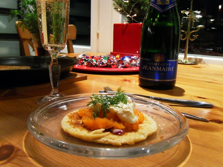 Vendace roe, smetana, red onion, dill with  a sprinkle of black pepper and lemon juice on a blini.
