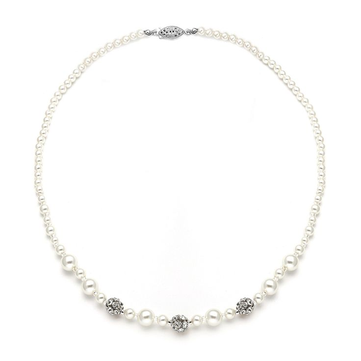 This beautiful wedding necklace features a lovely blend of assorted sized pearls highlighted with shimmering Austrian crystal rhinestone fireballs.