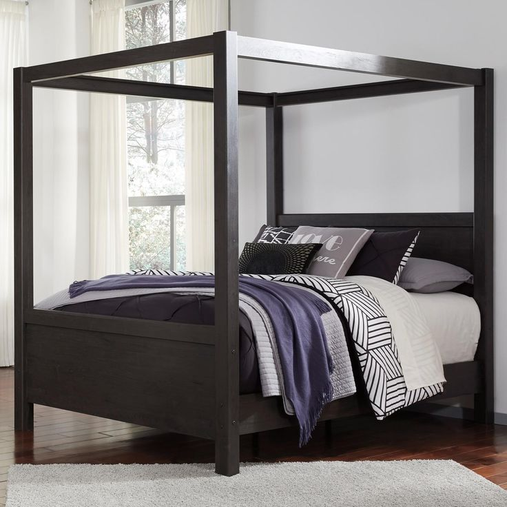 Dark charcoal finish over replicated Oak grain. Modern styled bed with  solid wood leg accents. Queen and king headboards can attach to a bolt-on  metal bed ...