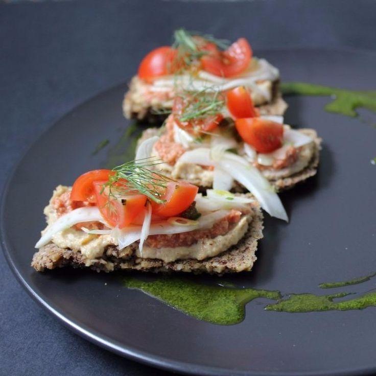 Fennel Flatbread with Zucchini hummus, muhammara, lemon tahini, fennel and capers.  Plantlab Culinary